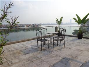 Big balcony, Lake view serviced apartment for rent with 03 bedrooms in Quang An, Tay Ho