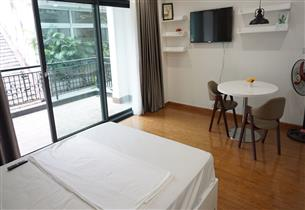 Big balcony studio for rent with 01 bedroom in Tran hung Dao, Hoan Kiem